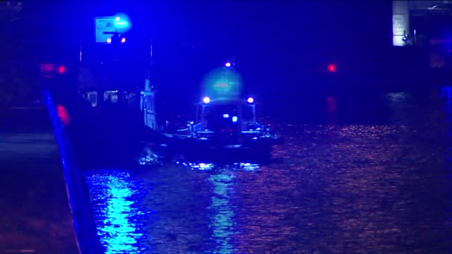 NYPD's Scuba Team searches the Hudson River for evidence at night in the case of cop killer suspect Tyrone Howard on October 23 2015 in New York City