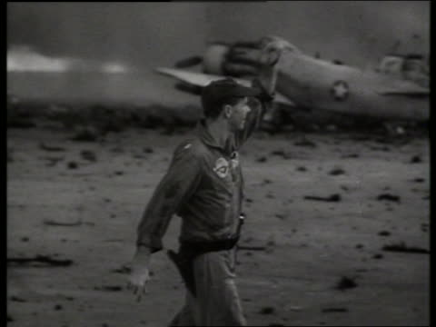 b/w 1960's soldier gesturing near airplanes at air base / vietnam / sound - only mid adult men stock videos & royalty-free footage