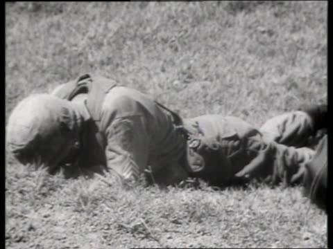 b/w 1960's soldier lying on ground / vietnam / sound - only mid adult men stock videos & royalty-free footage