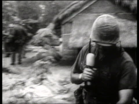 b/w 1960's soldier with microphone reporting in vietnam / sound - vietnam war stock videos & royalty-free footage