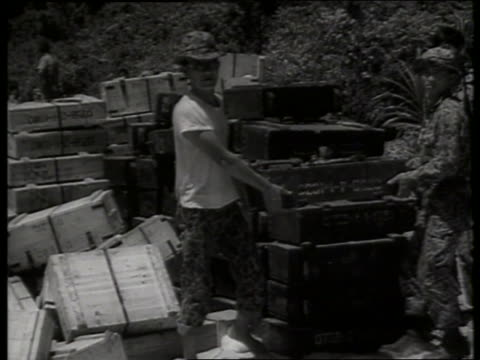 B/W 1960's soldiers carrying box of ammunition / Vietnam / SOUND