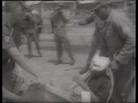 s soldiers carrying wounded man / vietnam / sound - vietnam war stock videos & royalty-free footage