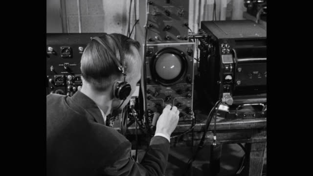 1950's - technician testing motor in laboratory - report produced segment stock videos & royalty-free footage