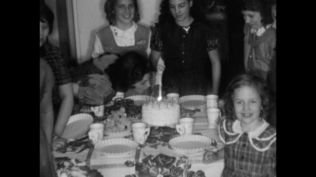 1950's Teeange Girl Blowing Birthday candles