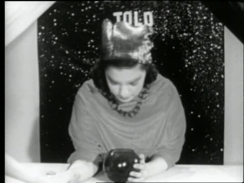b/w 1950's teen fortune teller looks into crystal ball then laughs / carnival - paranormal stock videos & royalty-free footage
