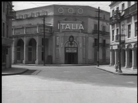 1930's pov through outdoor warner bros film set - warner bros stock videos & royalty-free footage