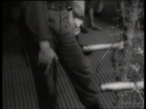 b/w 1960's tilt up from feet to head of vietnamese soldier / saigon / sound - only mid adult men stock videos & royalty-free footage