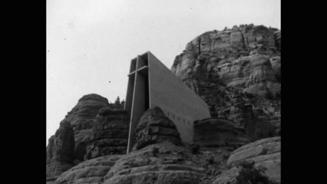 1960's tilt up shot of chapel of the holy cross on buttes of sedona, arizona, usa - sedona stock videos & royalty-free footage
