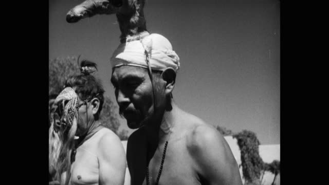 1950's tilt up shot of tribal people performing ceremonial dance - minority groups stock videos & royalty-free footage