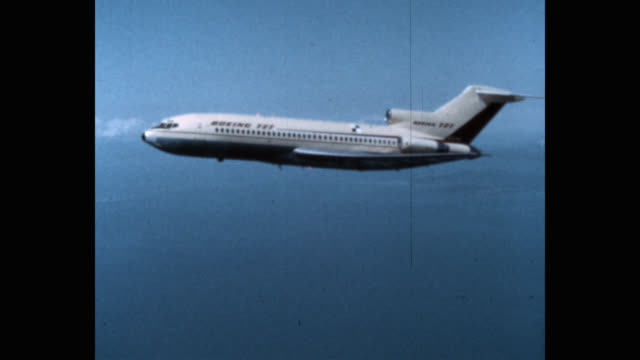 1960's - tracking shot of commercial airplane boeing 727 flying in sky - commercial aircraft stock videos & royalty-free footage