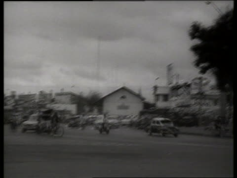 b/w 1960's traffic city street / saigon vietnam / sound - risciò video stock e b–roll