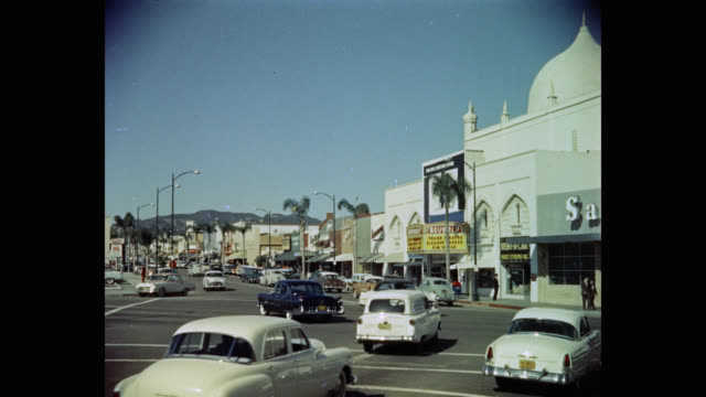 vidéos et rushes de 1950's traffic moving on street near the beverly theater, los angeles, california, usa - beverly hills