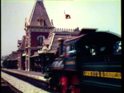 1950's WS Train pulls into station at Disneyland / Anaheim, California, USA / AUDIO