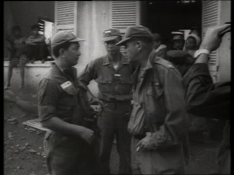 b/w 1960's us soldier talks to vietnamese soldier / vietnam / sound - south vietnam stock videos & royalty-free footage