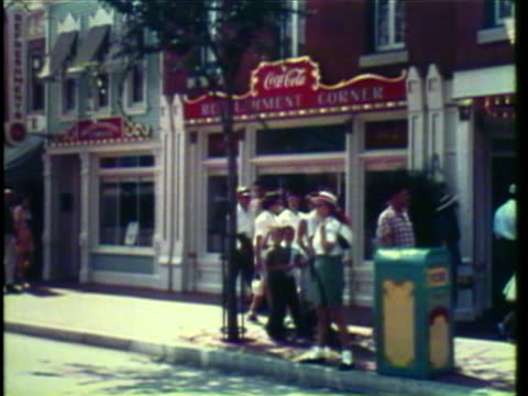 1950's WS POV View of station at Disneyland, Main street parade / Anaheim, California, USA / AUDIO