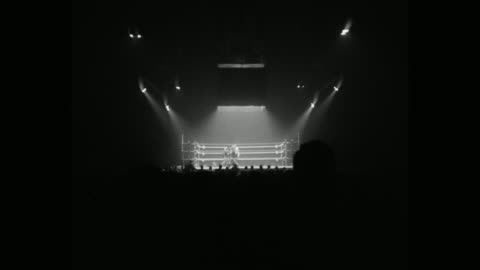 1950's wide shot of boxers competing in boxing ring - focus on background stock videos & royalty-free footage