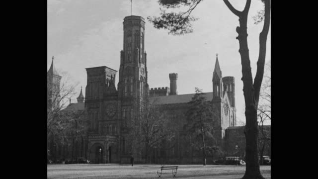 1930's wide shot of cars driving on street in front of smithsonian institution offices, washington, dc, usa - smithsonian institution stock videos & royalty-free footage