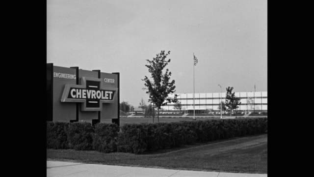 1950's wide shot of entrance sign to chevrolet engineering center - シボレー点の映像素材/bロール