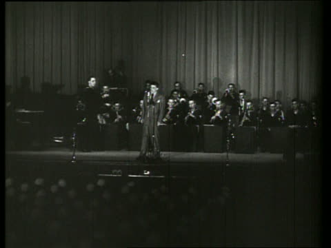 s wide shot of frank sinatra singing with orchestra on stage - frank sinatra stock videos & royalty-free footage