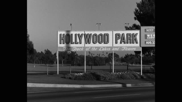 1950's wide shot of hollywood park sign, los angeles, california, usa - western script stock videos & royalty-free footage