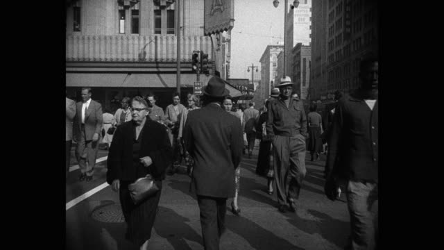 1950's - wide shot of people crossing street in city, los angeles, california, usa - full suit stock videos & royalty-free footage