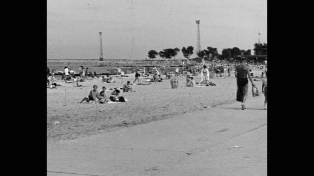 1950's - wide shot of people enjoying on beach, chicago, illinois, usa - swimwear stock videos & royalty-free footage