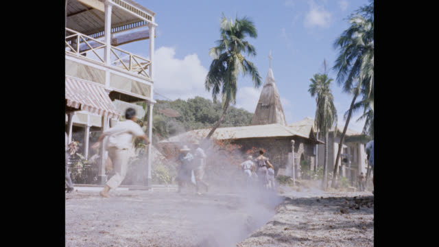1960's wide shot of people running through village during earthquake - film set stock videos & royalty-free footage