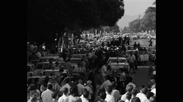 1960's wide shot of protestors and police officers on street, los angeles, ca, usa - talking politics stock videos & royalty-free footage