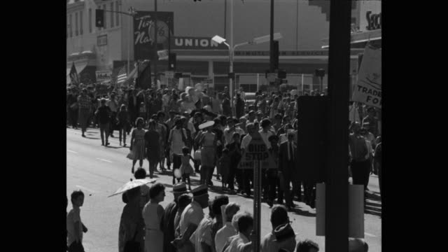 1960's wide shot of protestors protesting on street, los angeles, ca, usa - identity politics stock videos & royalty-free footage