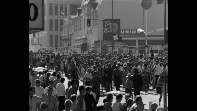 1960's wide shot of protestors protesting with placards and american flags on street, los angeles, ca, usa - identity politics stock videos & royalty-free footage