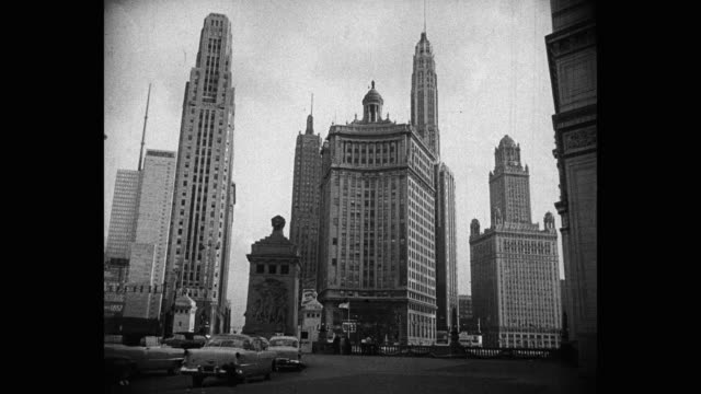 1950's - wide shot of skyscrapers in city, michigan avenue, chicago, illinois, usa - michigan avenue chicago stock videos & royalty-free footage