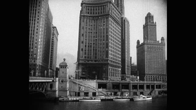 1950's - wide shot of skyscrapers in city, michigan avenue, chicago, illinois, usa - dusable bridge stock videos & royalty-free footage