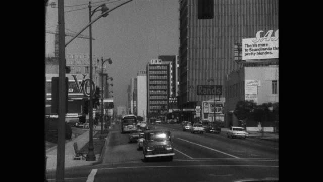 1960's - wide shot of traffic moving on wilshire boulevard, los angeles, california, usa - wilshire boulevard stock videos & royalty-free footage