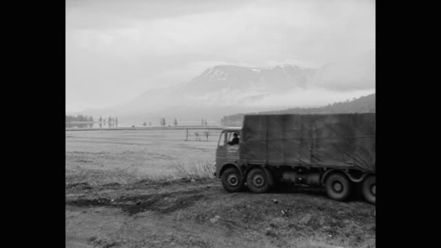 1960's - wide shot of truck driving off road in rural scotland - footprint stock videos & royalty-free footage