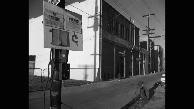 1960's - wide shot of warning sign on road in city, venice, ca, usa - road warning sign stock videos & royalty-free footage