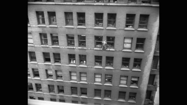 1950's window washer cleaning windows of building on e 23rd and lexington, new york city, new york state, usa - safety harness stock videos & royalty-free footage