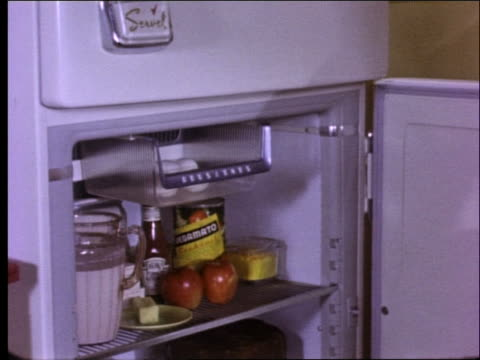 1950's woman taking eggs and butter from refrigerator - stay at home mother stock videos & royalty-free footage