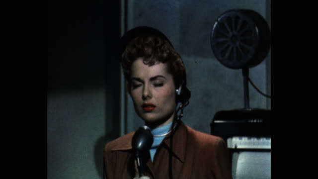 vídeos de stock e filmes b-roll de 1950's woman talking on microphone in space research organization - montagem de filme estúdio de cinema