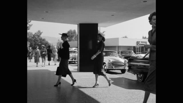 1950's - women arriving at hotel for fashion show - grace stock videos & royalty-free footage