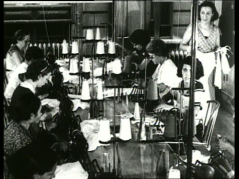 b/w 1930's women sewing at table in large room / sound - 1930 stock videos & royalty-free footage