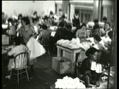 b/w 1930's women sewing at tables in large room / sound - 1930 stock videos & royalty-free footage