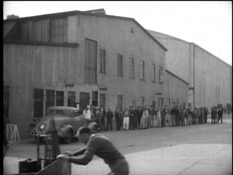 1930's workers waiting in line at warner bros studios - warner bros stock videos & royalty-free footage