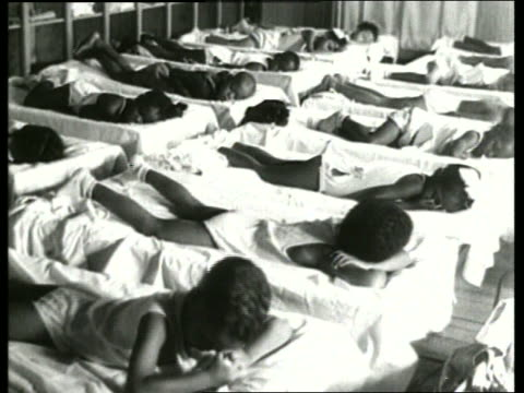 b/w 1930's young black children sleeping in beds / sound - 1930 stock videos and b-roll footage