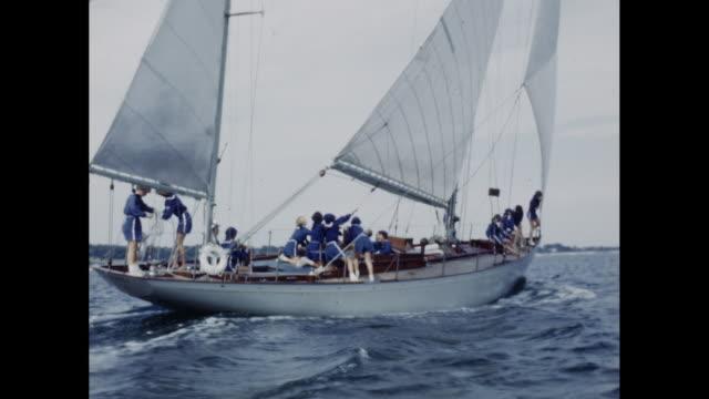 vidéos et rushes de 1950's young women in blue uniforms crew a sailboat - équipe de voile