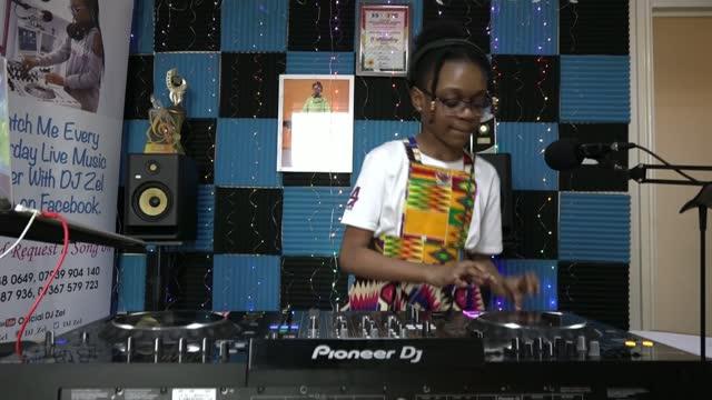s youngest radio dj raises money for education projects; england: london: newham: ext parents of zelda manteaw onto balcony jennifer manteaw... - news not politics video stock e b–roll