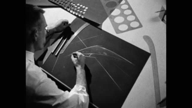 1960's - zoom in shot of engineer using drafting tools to draw outline on blueprint in office - only mid adult men stock videos & royalty-free footage
