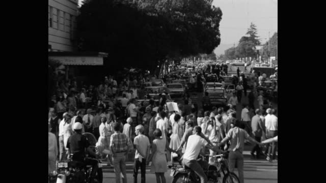 1960's zoom in shot of protestors and police officers on street, los angeles, ca, usa - talking politics stock videos & royalty-free footage