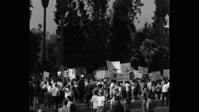 1960's zoom out shot of protestors protesting with placards on street, los angeles, ca, usa - placard stock videos & royalty-free footage