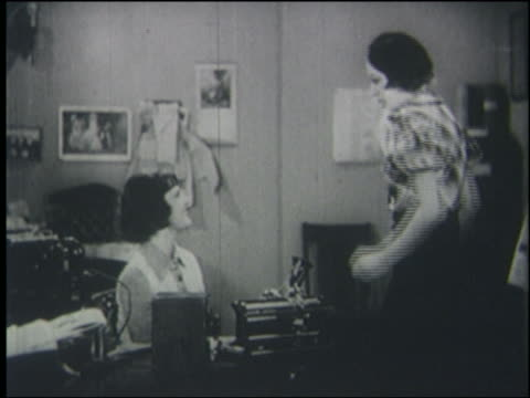 B/W 1930's/40's woman slaps secretary (Gay Seabrook) sitting at desk + spins her around