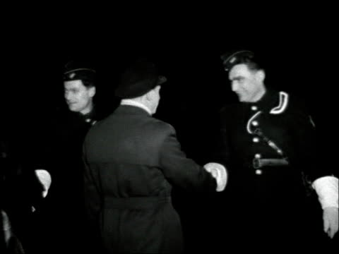 Saar joins West German Republic Chancellor Adenauer attends celebrations GERMANY Saarbrucken EXT / NIGHT Two shots people parading with torches /...